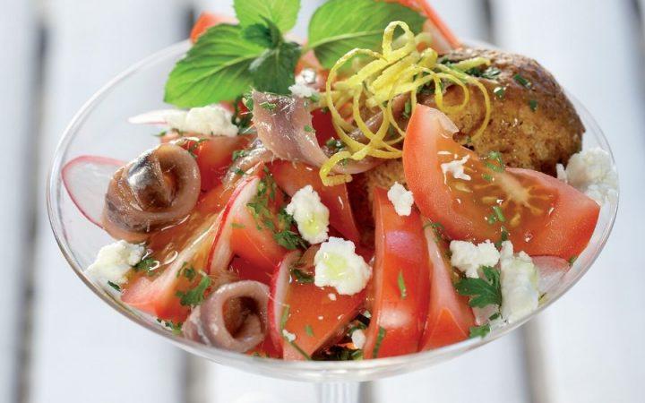 Summer salad with Tomatoes, barley rusks, Feta, Anchovies and Herbs